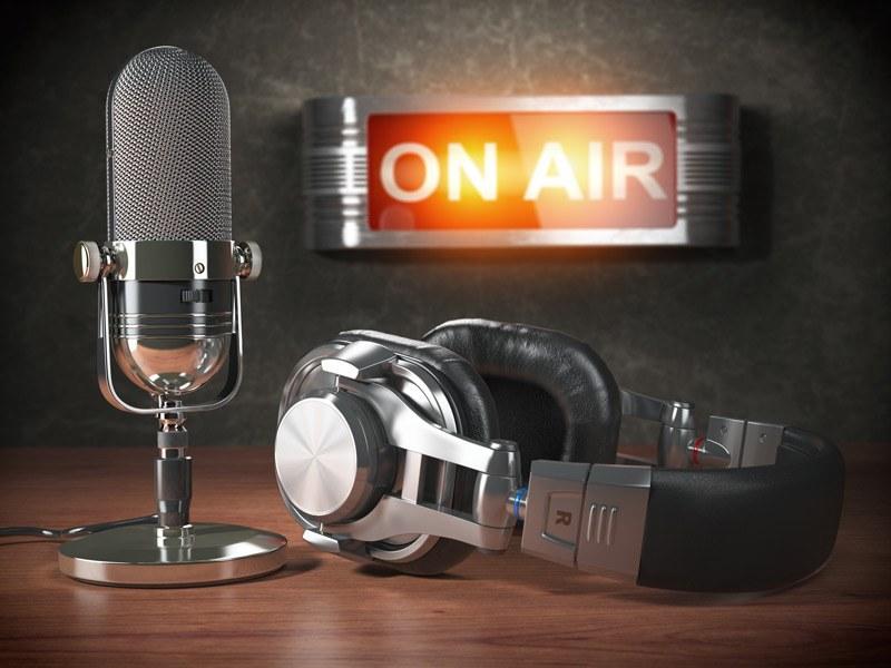 microphone and headphones in radio studio on air.